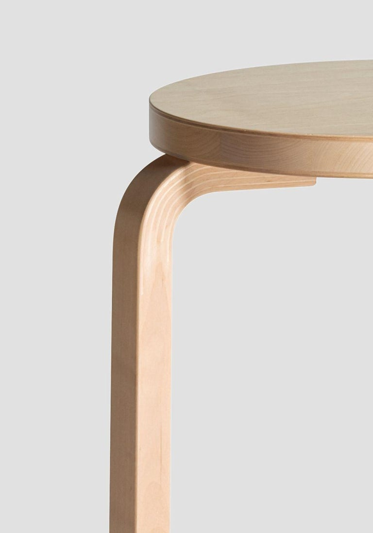 Authentic Stool E60 in birch by Alvar Aalto & Artek. Projecting a sense of relaxed familiarity, Stool E60 is equally suited to the home, public buildings, and educational facilities. The legs are mounted directly to the underside of the round seat