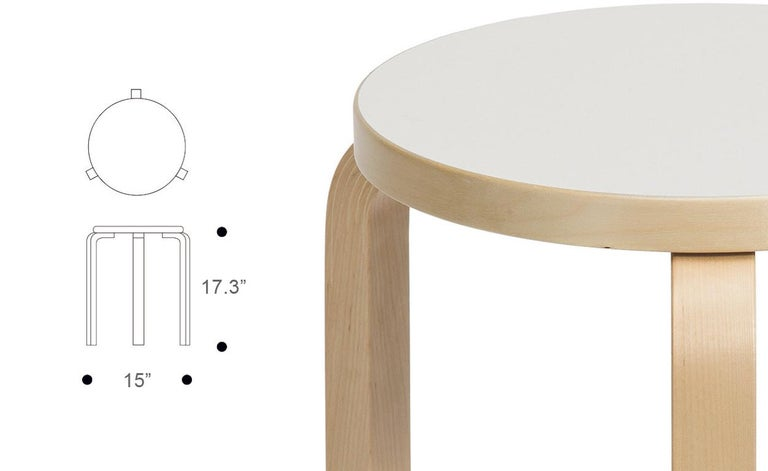 Authentic stool E60 in lacquered birch with laminate seat by Alvar Aalto & Artek. Projecting a sense of relaxed familiarity, stool E60 is equally suited to the home, public buildings, and educational facilities. The legs are mounted directly to the