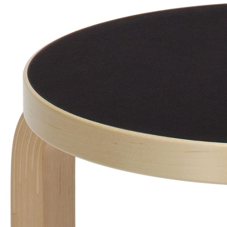 Authentic stool E60 in lacquered birch with linoleum seat by Alvar Aalto & Artek. Projecting a sense of relaxed familiarity, stool E60 is equally suited to the home, public buildings, and educational facilities. The legs are mounted directly to the