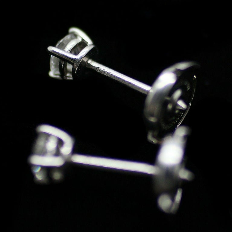 Round Cut Authentic Stud Earrings of Round Brilliant Diamonds in Platinum .50pts For Sale