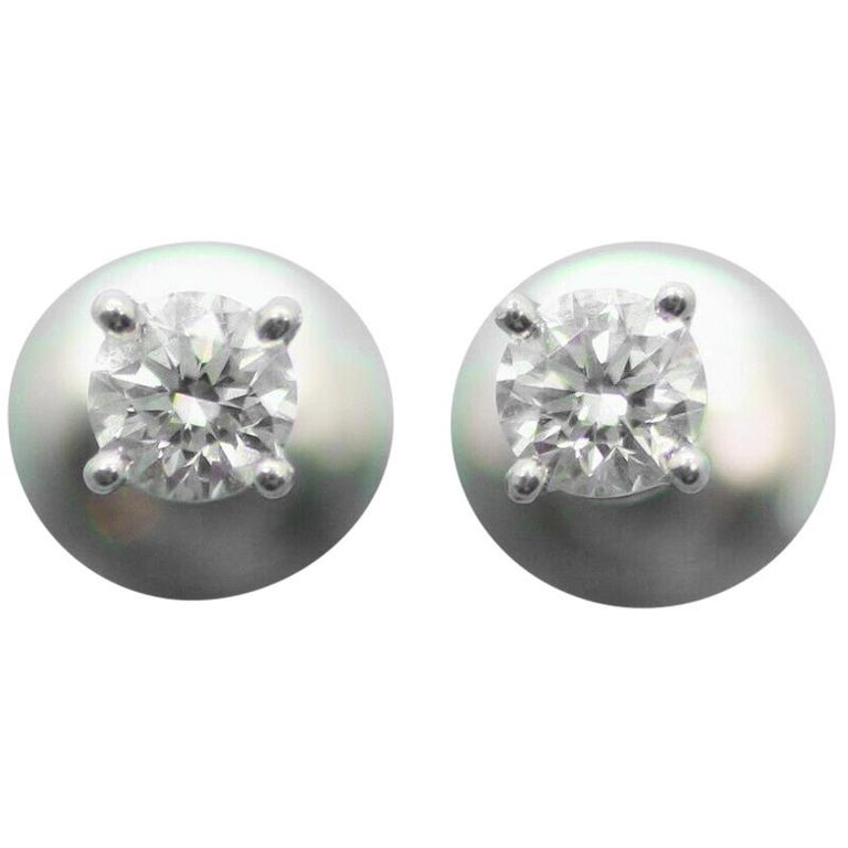 Authentic Stud Earrings of Round Brilliant Diamonds in Platinum .50pts For Sale