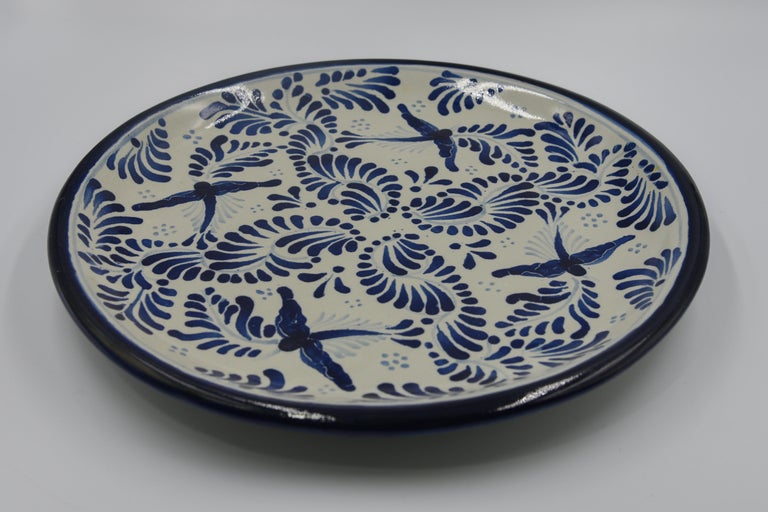 This decorative Talavera plate is a contemporary example of Talavera today. Artist Cesar Torres unmasks the past and portraits the present in a vide-poche -- rustic Mexican elegance. 