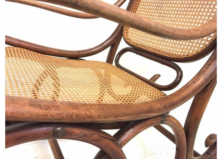 Molded beechwood Antique Thonet rocking chair in good condition.  The Art Nouveau Classic.  Though American inventor Benjamin Franklin is sometimes credited with inventing the rocking chair, historians actually trace the rocking chair's origins