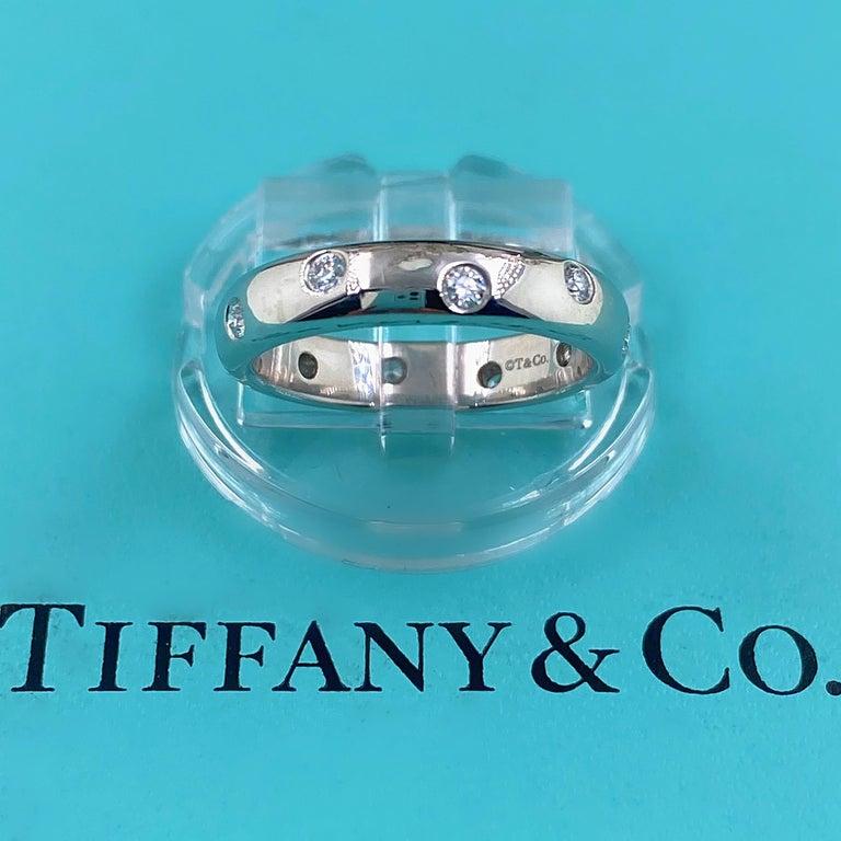 Tiffany & Co. ETOILE Diamond Band  Style:  Diamond Wedding Band Metal:  PT950 Platinum Size:  5.75  Width:  4 MM  TCW:  0.22 tcw Main Diamond:  Round Brilliant Diamonds Color & Clarity:  E - F, VS Hallmark:  ©T&CO. PT950 Includes:  T&C Ring