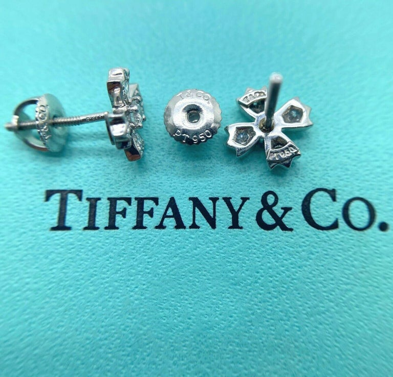 Authentic Tiffany & Co. floret stud earrings of round brilliant diamonds in platinum. Round brilliant diamonds, carat total weight .70, color grade G, clarity grade VVS2. Specifications:     main stone:DIAMONDS     diamonds:10 PCS     carat total
