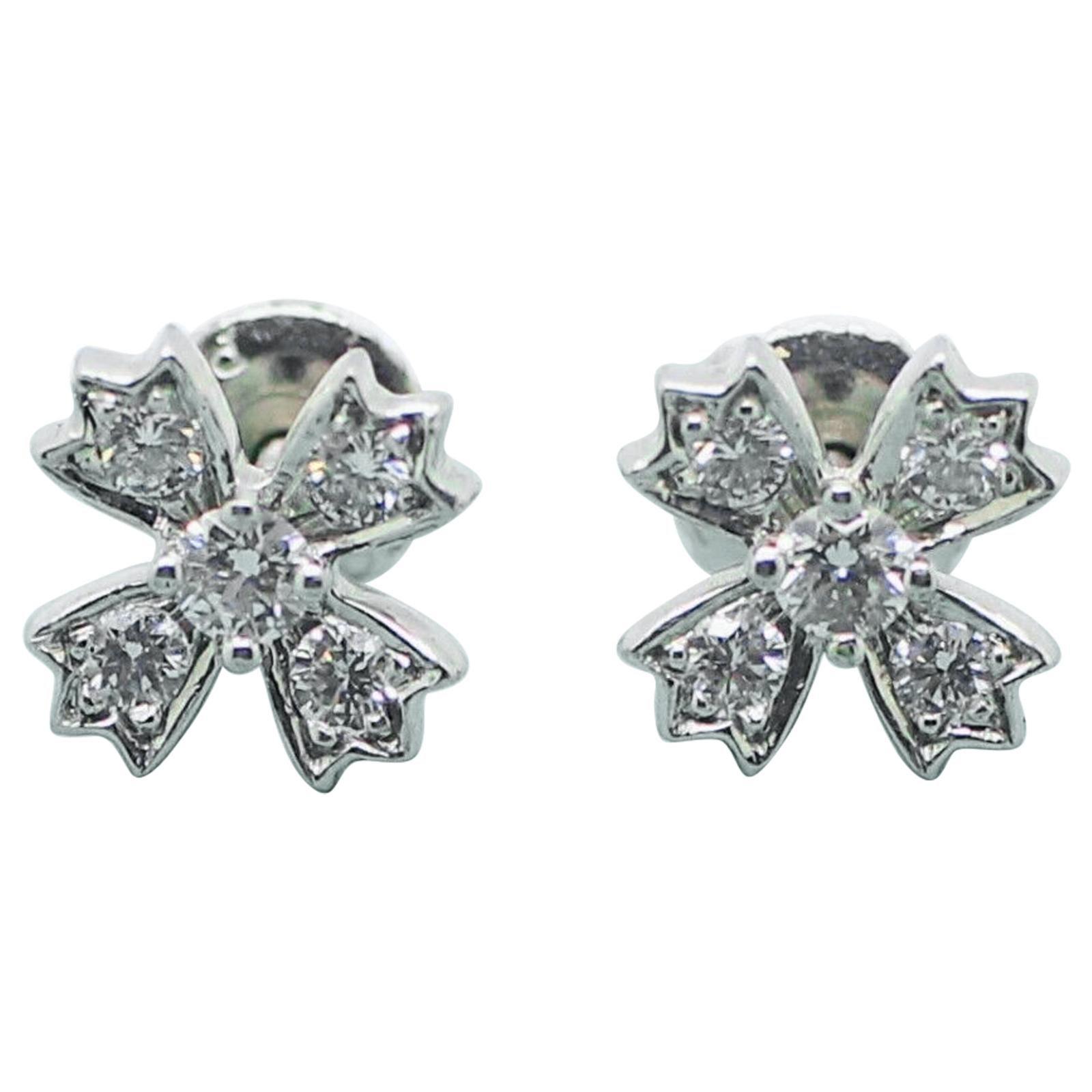 Authentic Tiffany & Co. Floret Stud Earrings of Round Brilliant Diamonds