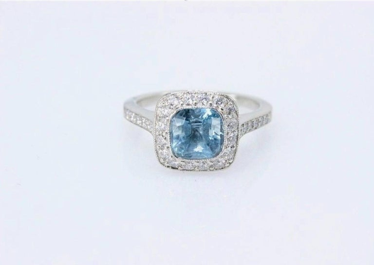 Tiffany & Co. Engagement Ring Style:  Legacy Aquamarine Ring Serial Number:  29239312  Metal:  Platinum PT950 Size:   4.75 - sizable   Total Carat Weight:   1.57 CTS Center Stone:  Aquamarine Cushion Cut 1.15 CTS Diamond Shape:  Round Brilliant