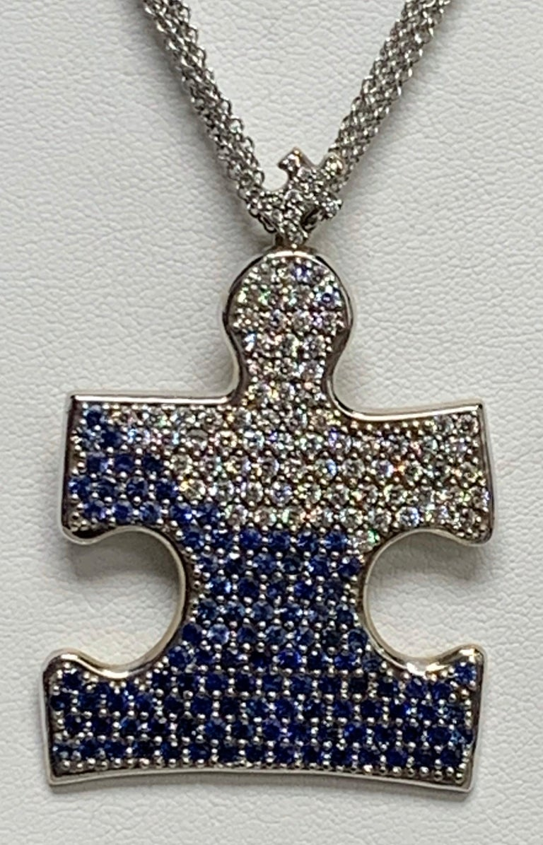 Autism Speaks Symbol is made into this amazing necklace with a purpose and a story.  Most people see a piece of a puzzle when looking at this.  Scott designed it as a child sitting with open arms wanting to be held.  The child is transcending from
