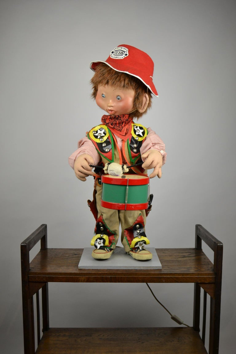 1960s vintage automaton of a Texas cowboy doll playing drum.