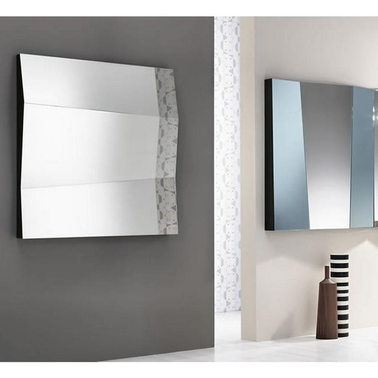Big mirror surfaces at alternate inclination give the functionality a new aesthetic sense. Designed by Giovanni Tommaso Garattoni  Made in Italy: Made in Italy furniture means design, quality, style and sophistication. The typical elegance of
