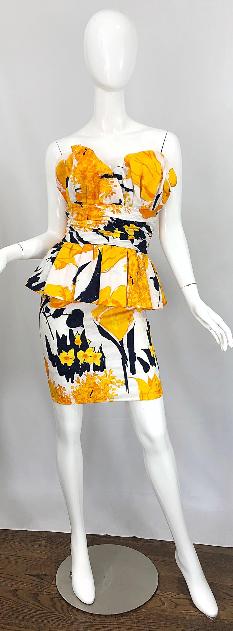 Avant Garde 1980s ARMEN WARDY yellow, black, marigold and white strapless silk mini dress! Features abstract flower prints throughout. Heavy attention to detail with built in support to hold everything in place. Flattering peplum at hips. Hidden