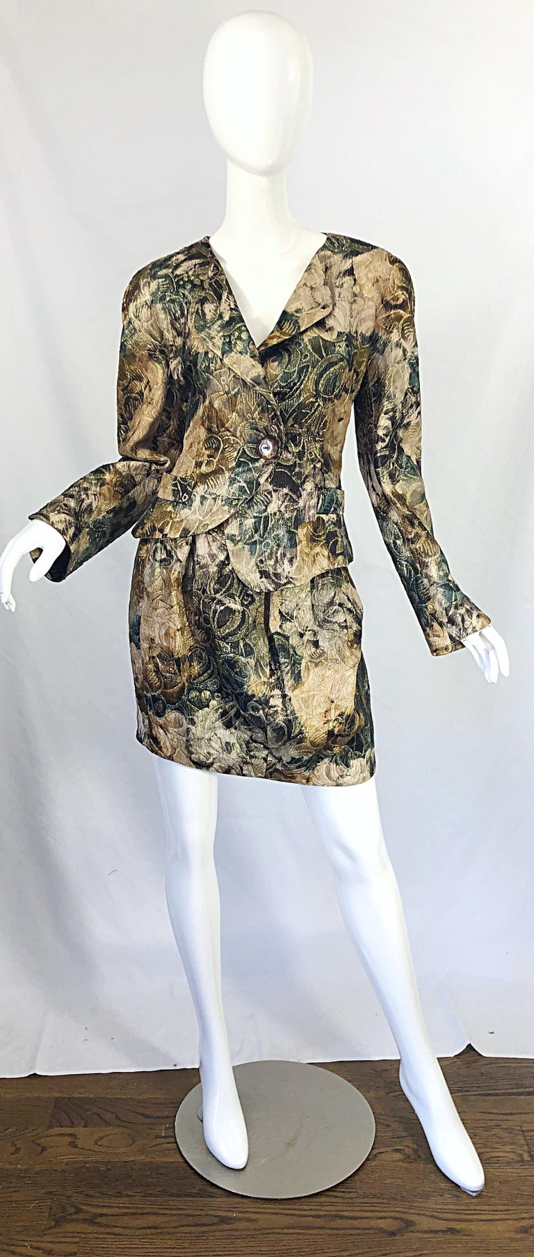 Avant Garde early 90s KRIZIA asymmetrical silk skirt suit ! Features warm hues of hunter green, brown, tan and ivory throughout. Asymmetrical hem on the jacket and each collar. Single button closure with snap. High waisted mini skirt has hidden