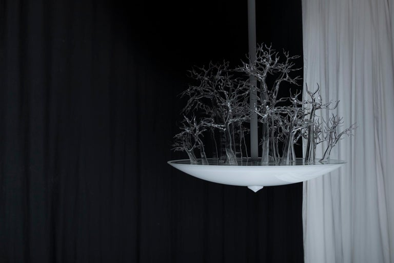 This chandelier demonstrates the true versatility of glass. Through