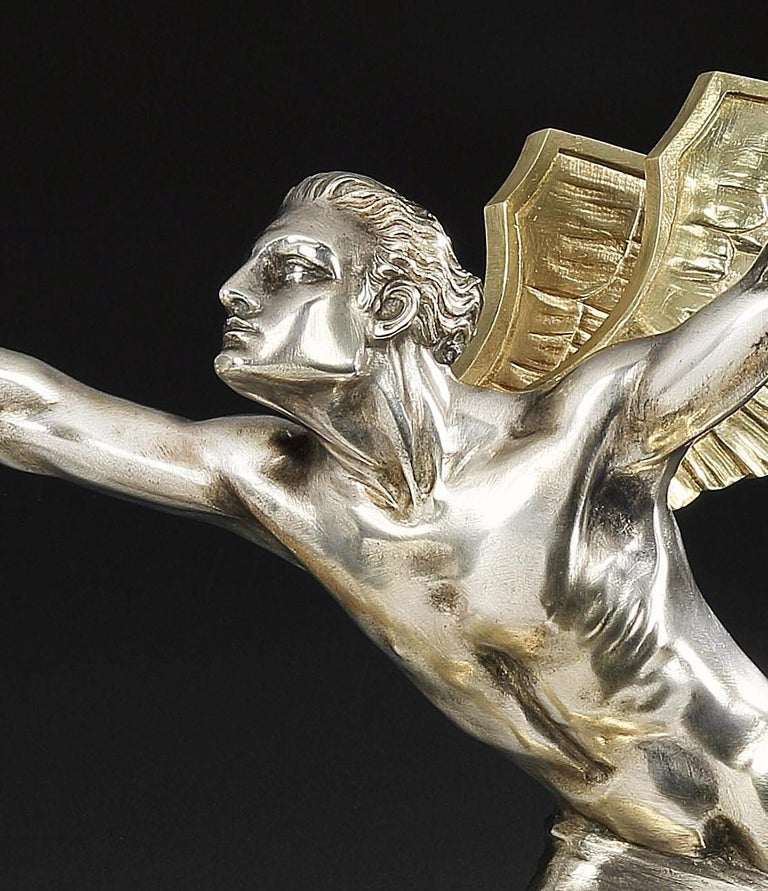 A highly evocative Art Deco bronze, depicting a typical 'Speed God' by French sculptor Frederic C. Focht (1879-1937). The silvered and gilded bronze portrays the sculptor's willingness to embrace the Machine Age in a period of history where the