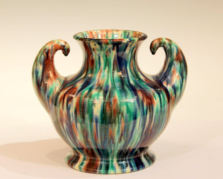 Awaji Pottery vase in Art Deco form with outstreched arms flexing and striking flambe glaze, circa 1930. Impressed marks. Measure: 6