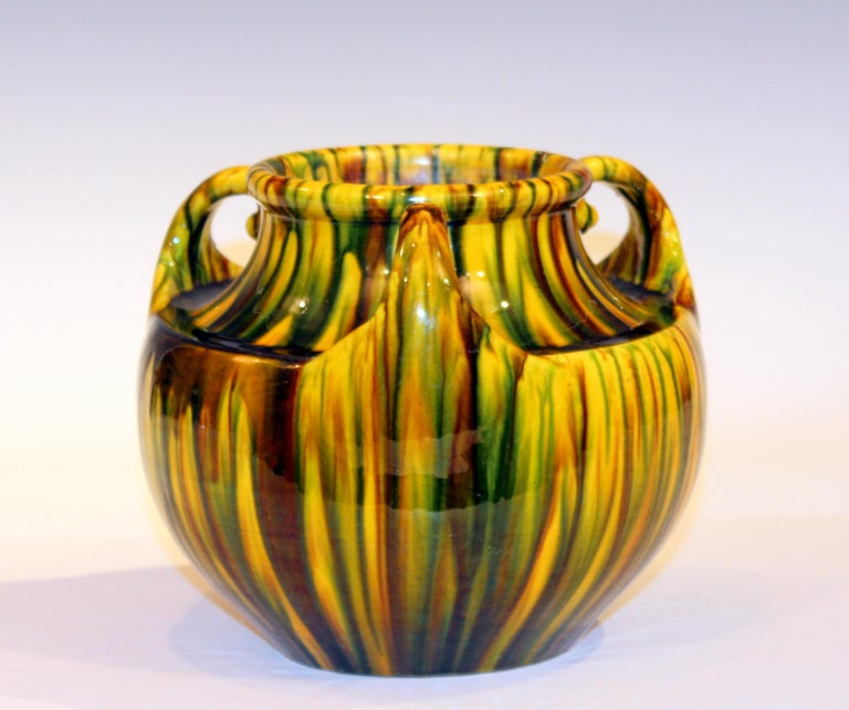 Awaji Pottery vase in Art Deco form with three curled up handles and striking yellow flambé glaze, circa 1930. Impressed marks. 6