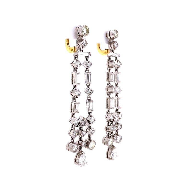 Fabulous Chandelier Diamond Drop Earrings. Beautifully Hand crafted in Platinum. Hand set with alternating round, square and baguette diamonds with a pear shape diamonds at the bottom of each. Approx. 3.90tcw; color: G/H – clarity: VS/SI. Measuring