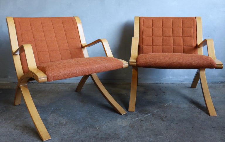For your consideration are these spectacular Ax lounge chairs in original condition featuring bent wood frames and original burn orange tufted wool upholstery. Very comfortable and striking design.