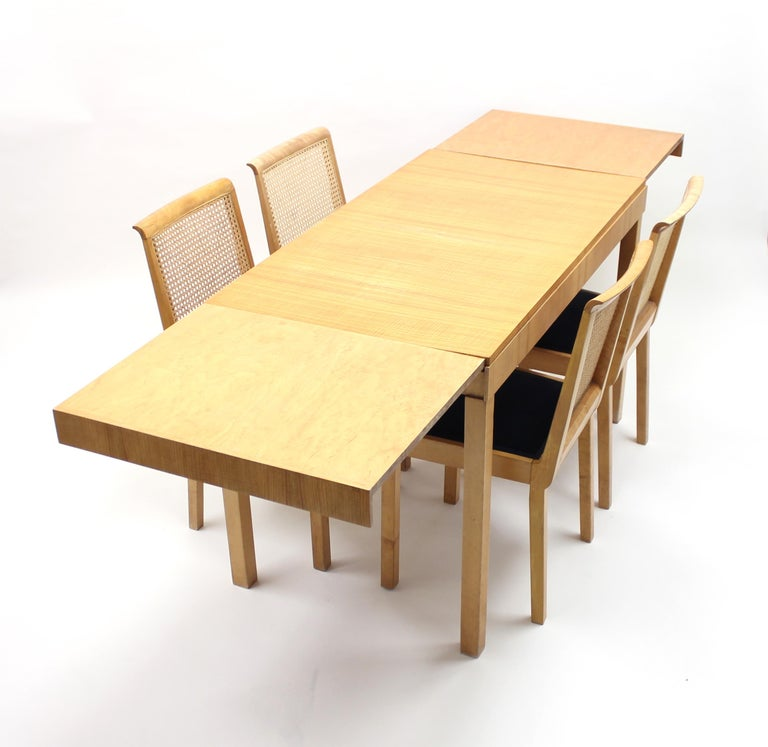 Rare dining set designed by Axel Einar Hjorth for Nordiska Kompaniet (NK) in the first half of the 1930s. It features as set of 4 Corall chairs and a Typenko table with two extra leafs tucked underneath the table top. The table measures 120 cm in