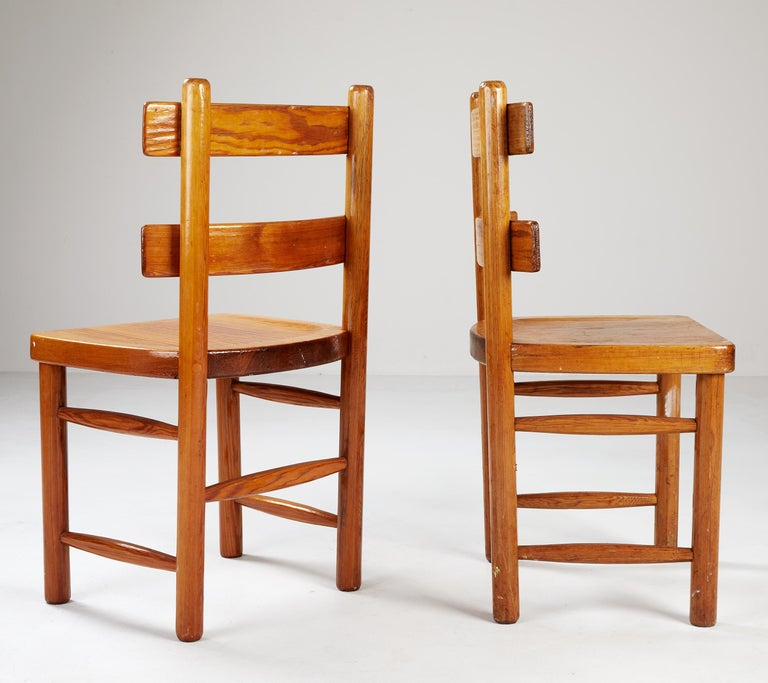 A pair of side or dining chairs by Swedish designer & architect, Axel Einar Hjorth, executed by Nordiska Kompaniet in April 1929. Registrated number in the NK drawing index. Both marked with manufacturer´s metal plaque. Pine & wrought iron. Named