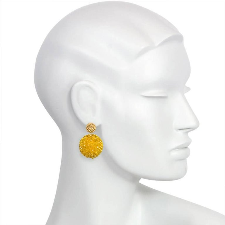 A pair of handmade double ball earrings with extra small gold electroplated glass beaded tops and larger sunflower yellow crystal beaded bottoms, in 18k gold.  Axel Russmeyer.  11mm top, 26mm bottom