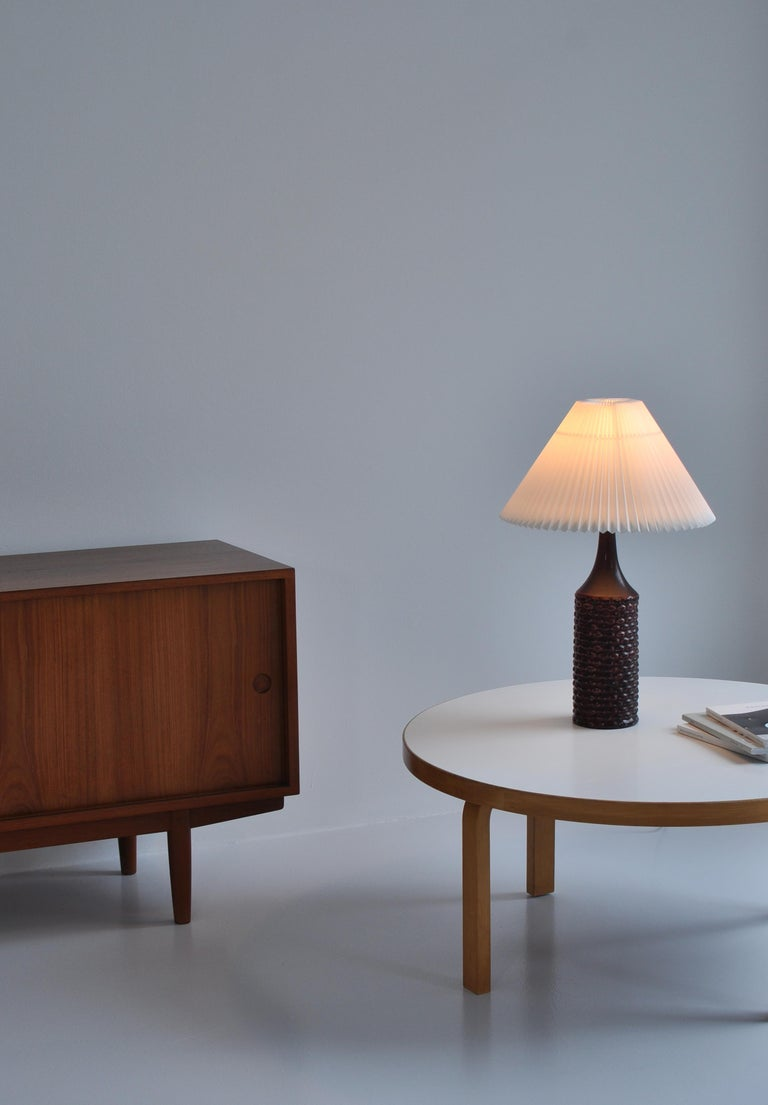 Rare and beautiful stoneware lamp by Axel Salto for Royal Copenhagen, Denmark in 1958. The lamp base is modeled in Salto´s signature