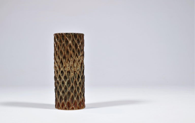Cylindrical vase in budded style decorated with beautiful sung glaze by Axel Salto for Royal Copenhagen. Signed: Salto and with three waves, design no. 20564.