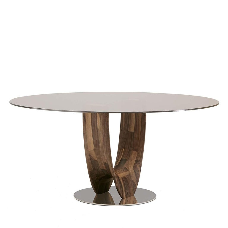 This elegant round table is part of the Axis collection designed by Stefano Bigi. A stunning addition to a modern dining room or large entryway, this piece boasts a transparent bronze glass round top that gives an unobstructed view of the exquisite