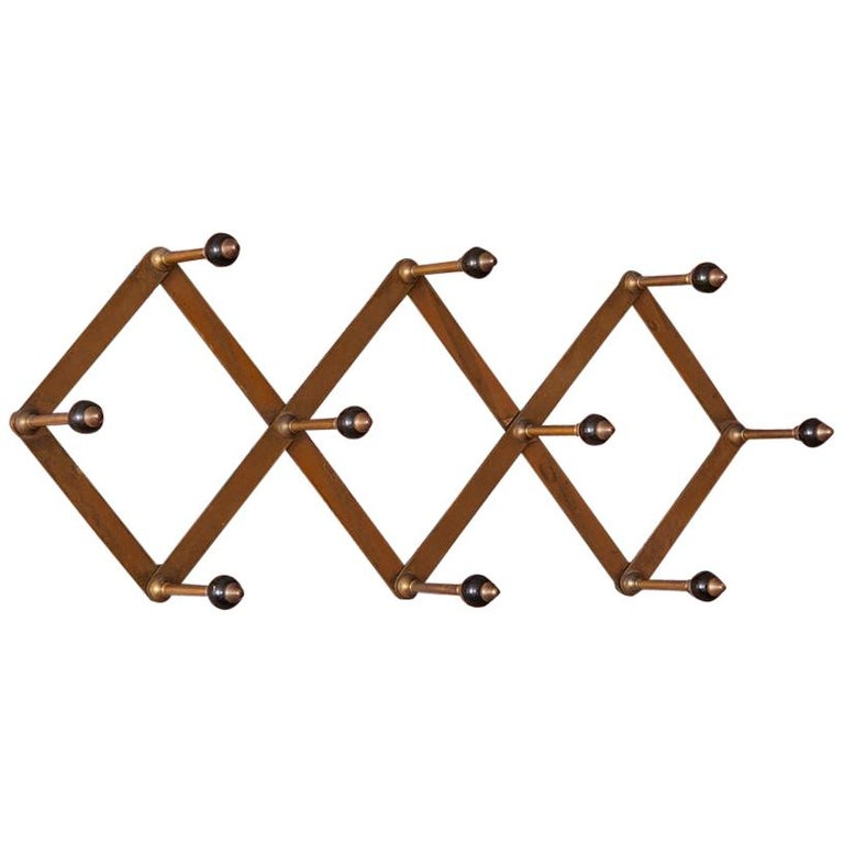 Azucena Coat Hanger in Polished Brass and Bakelit by Luigi Dominioni, Italy