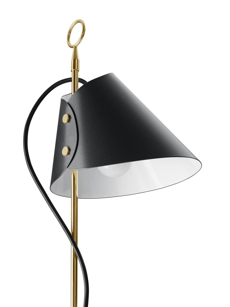Stem in polished brass, base in black painted cast iron. Sliding reflector in metallic grey aluminium. Designed by Luigi Caccia Dominioni in 1953 for Azucena. Contemporary re-edition made by Azucena.
