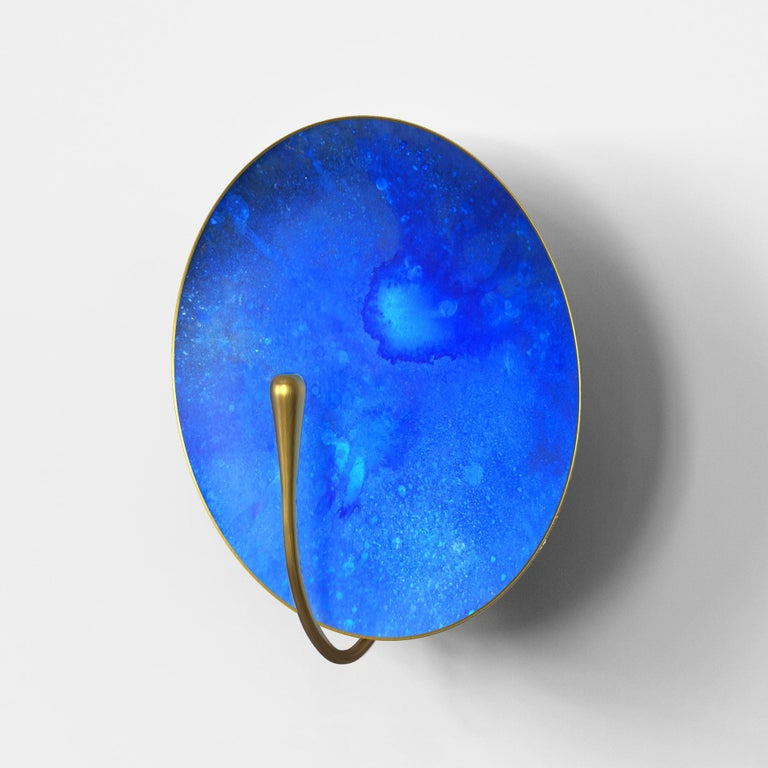 A gentle silhouette of a plate makes up this unique wall light. A bright, indigo patina paint is applied to create this unique finish. Please note the process is slightly random and each plate has a variant finish. Sitting happily in many interiors,