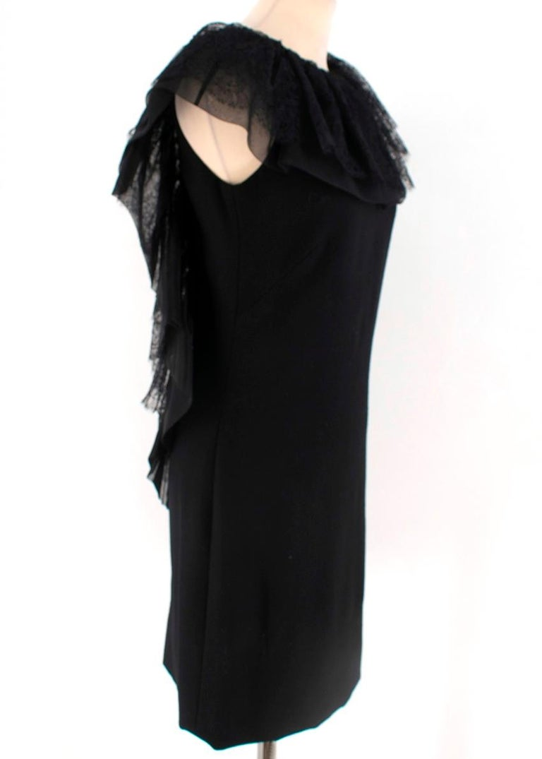 Azzaro 'Gazette' black wool dress with low V-shaped back. This dress features large chiffon, silk and lace trim, a high round-neck and jewel button fastenings.     - Jewel button fastenings through the back  - 100% wool; chiffon trim: 100% silk;