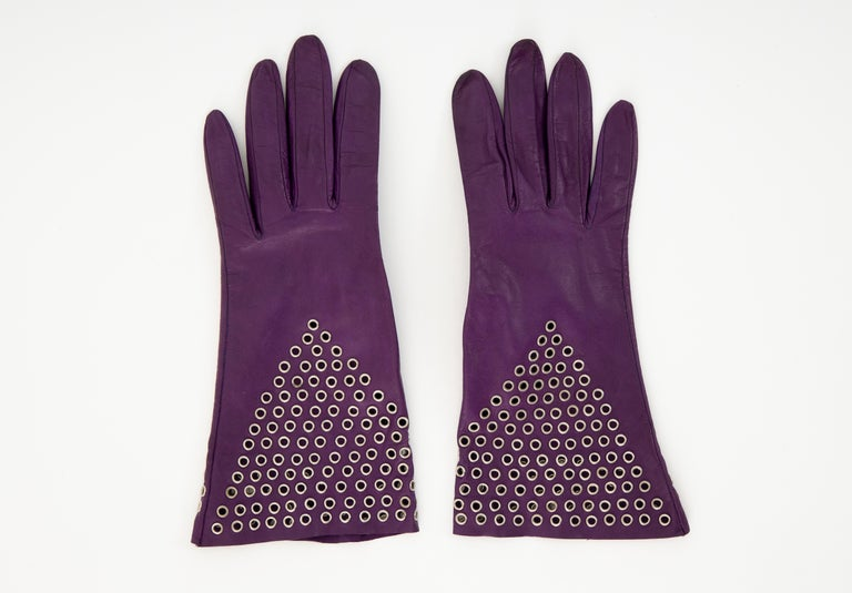 Azzedine Alaïa plum leather gloves with gold-tone grommets.  Length: 10