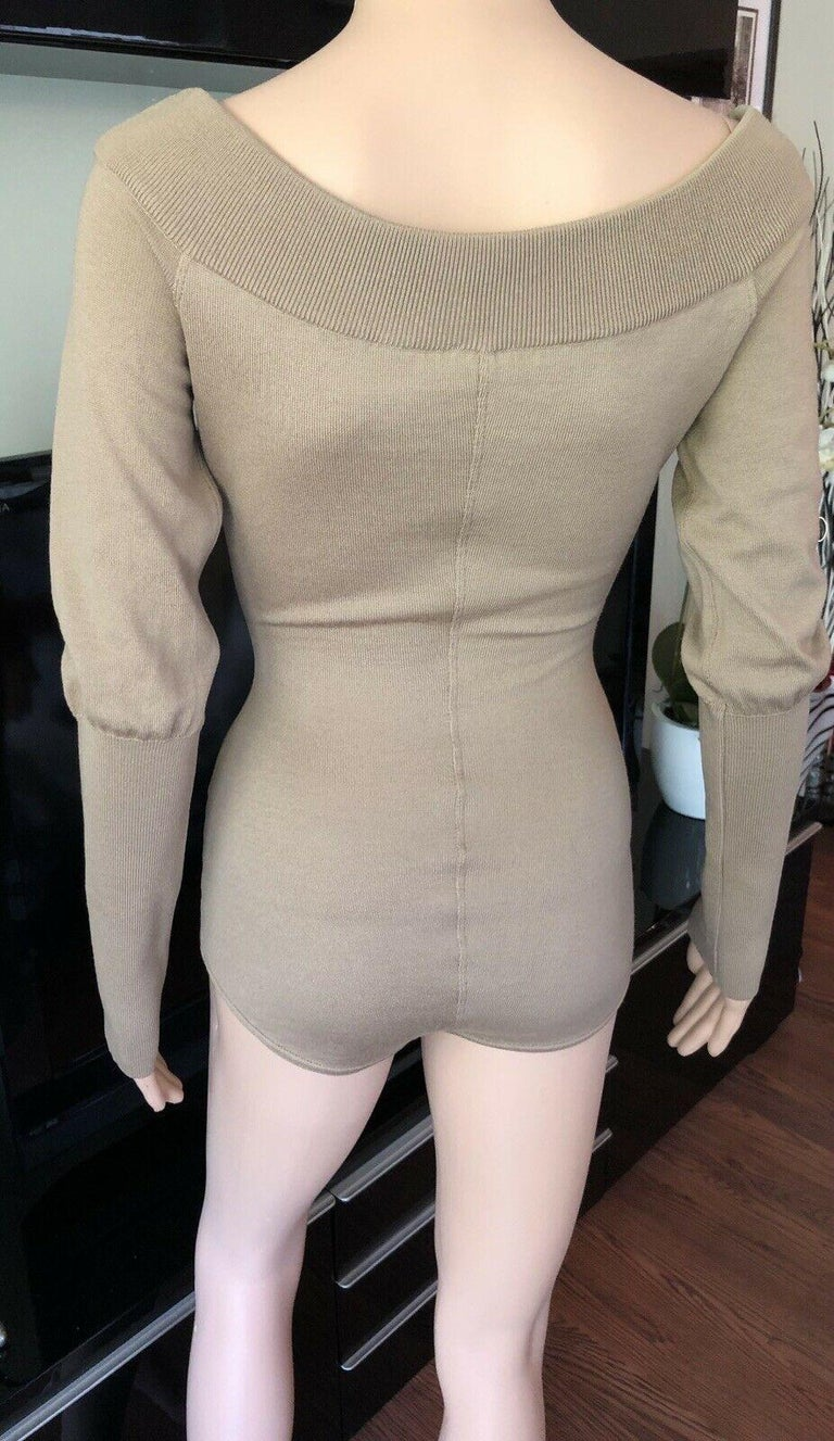 Azzedine Alaia 1990's Vintage Bodysuit Romper S  Alaïa virgin wool medium-weight off-the-shoulder knit bodysuit with rib knit trim, long sleeves and button closures at hem.  All Eyes on Alaïa  For the last half-century, the world's most fashionable