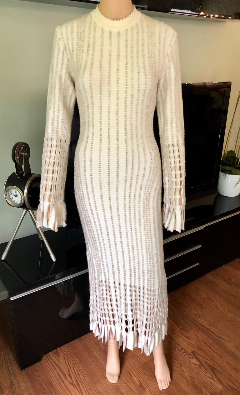 Azzedine Alaia 1990's Vintage Knit Fringed Laser Cut Midi Dress XS  Alaïa knit midi dress featuring fringe accents on the bottom and sleeves, crew neckline, long flared sleeves and concealed zip closure at center back.