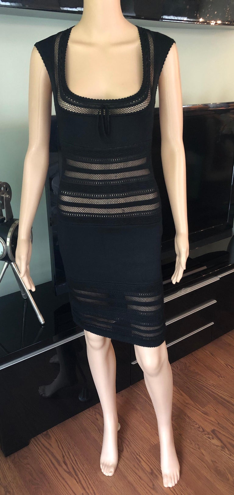Azzedine Alaia 1990's Vintage Fitted Semi-Sheer Bodycon Black  Dress Size XS  Alaïa sleeveless bodycon mini dress with open knit paneling throughout, scoop neck featuring tonal bow accent at collar, scalloped trim and concealed zip closure at center