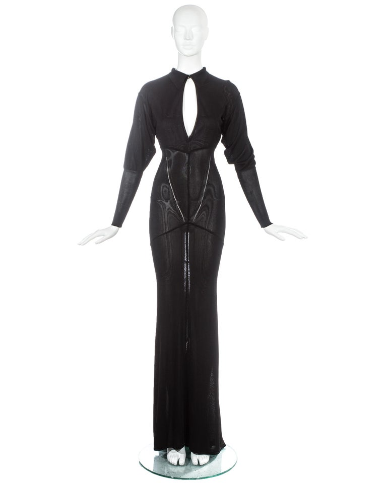 Azzedine Alaia; Black acetate knit evening maxi dress with peek-a-boo cleavage and train.  Fall-Winter 1986