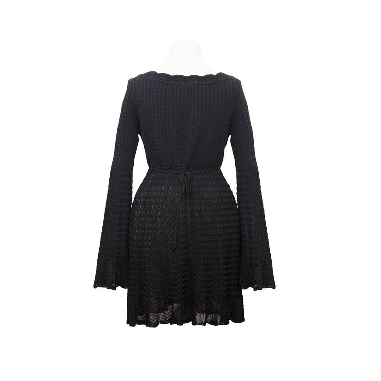 Alaia bell sleeve black knit dress with loose tie at the back.  Made in Itay, 90% viscose, 6% nylon, 4% elastic Size : M Measurments :  Shoulders - 37cm waist: - 64 cm sleeves - 65 cm total length - 75cm