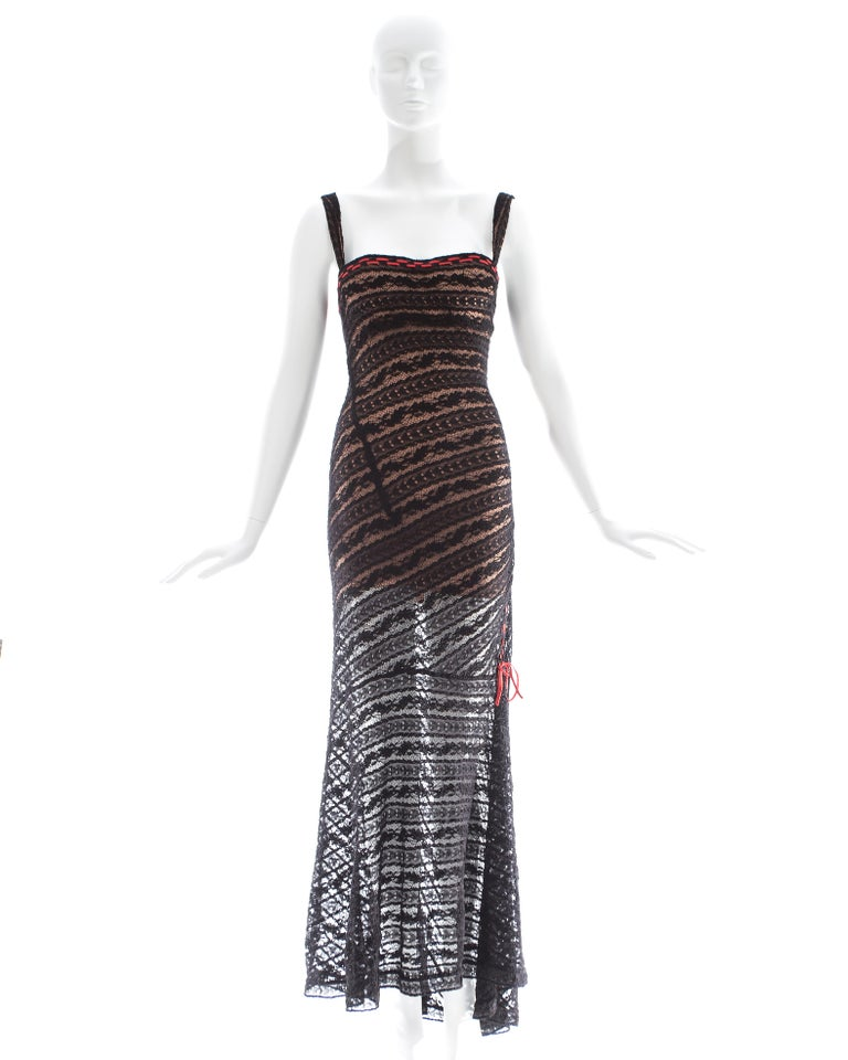 Azzedine Alaia; black lace knit evening dress with built in padded bra and spandex nude mini dress.  Fall-Winter 1993