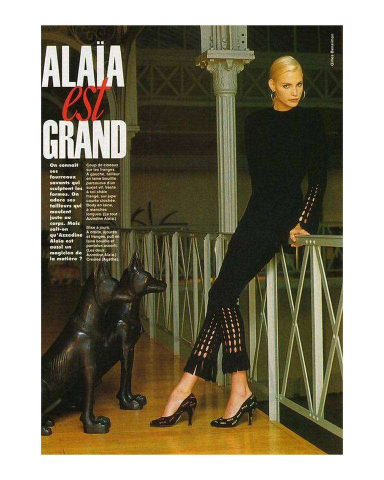 Azzedine Alaia black laser cut boiled wool fringed pant suit.  Micro mini dress with flared sleeves and fitted high waisted pants with fringed hem.   Fall-Winter 1993
