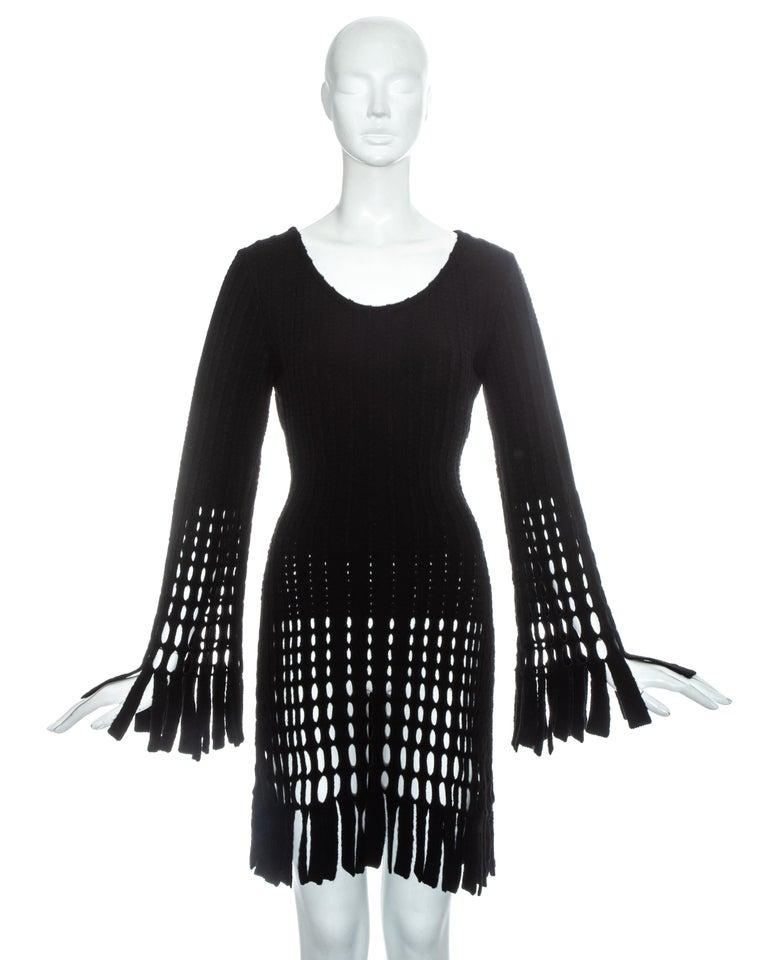 Azzedine Alaia black laser cut boiled wool fringed tunic.   Fall-Winter 1993