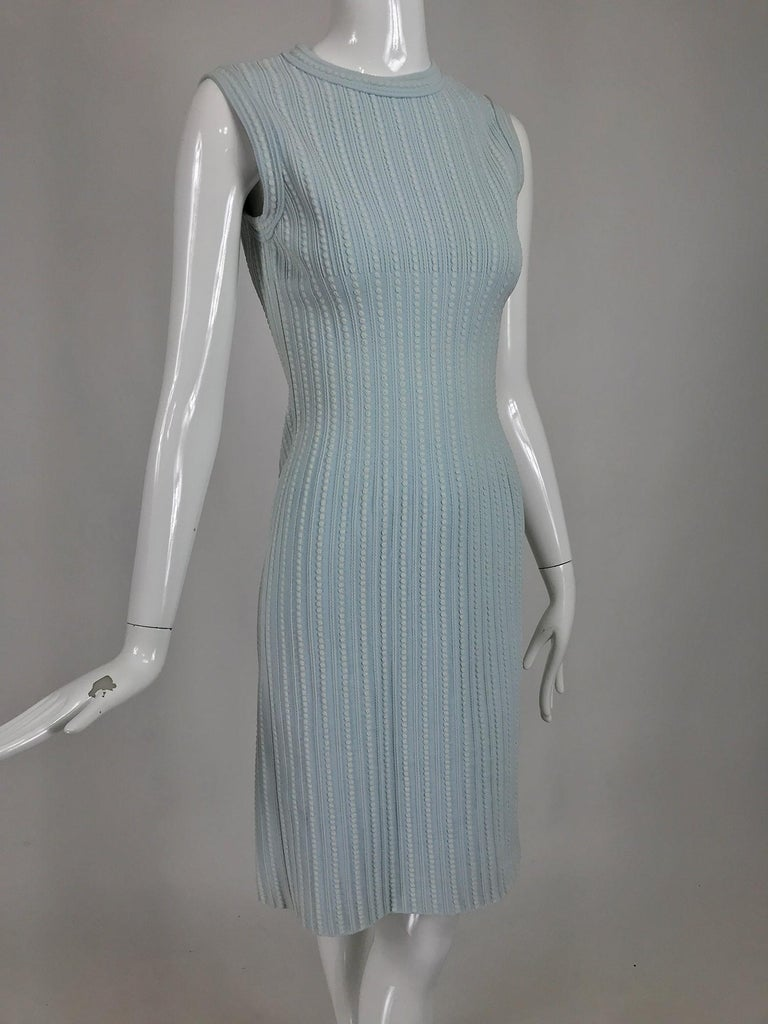 Azzedine Alaïa robins egg blue and cream fitted stretch body con dress. Raised textured stretch viscose sleeveless dress has a jewel neckline, the neck and arm openings are done in self bands of fabric. The dress is fitted and body hugging. Has the