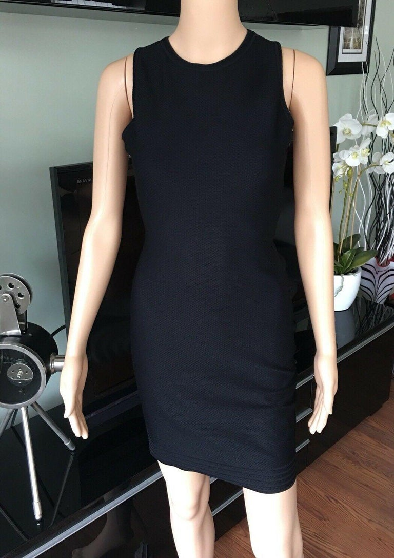 Azzedine Alaia Sexy Open Back Fitted Dress Size FR 38  Black Alaïa sleeveless knit mini dress with crew neck, cross-over straps at open back and concealed zip closure at side.  All Eyes on Alaïa  For the last half-century, the world's most