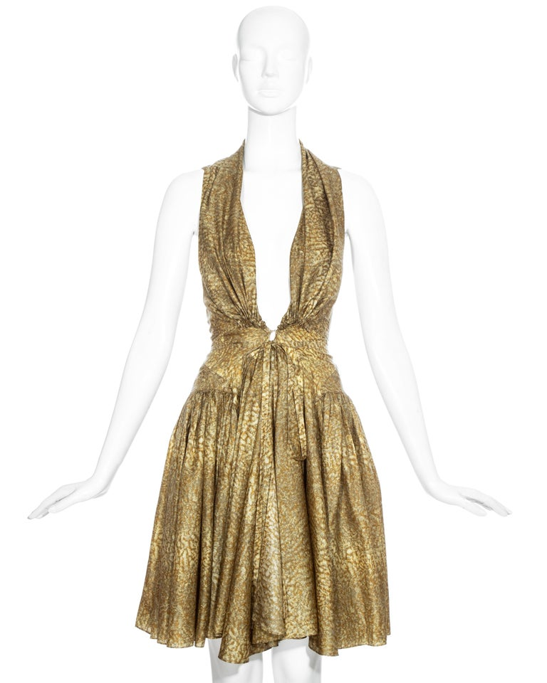 Azzedine Alaia gold silk mid-length evening dress with drawstring fastenings on bust and waist, pleated skirt and open sides.   Famously worn by Madonna for Cosmopolitan Magazine (July 1987) ph. Francesco Scavullo.   Spring-Summer 1987