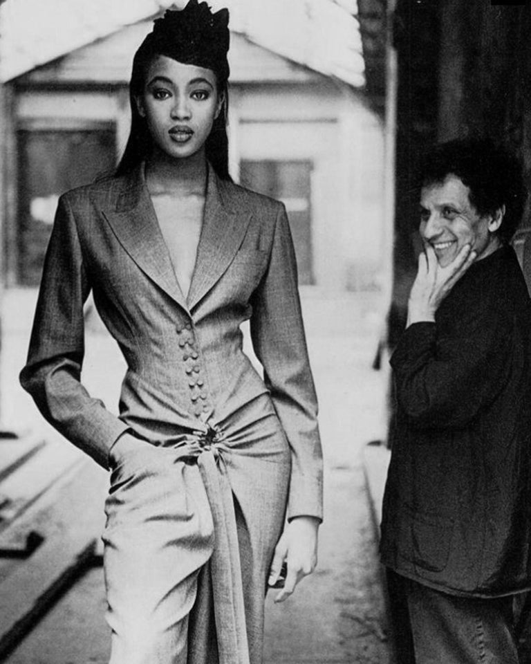 Azzedine Alaia grey lightweight wool wide leg jumpsuit with double breasted button closures, fitted waist and circular drawstring fastening on lower waist.   Spring-Summer 1988