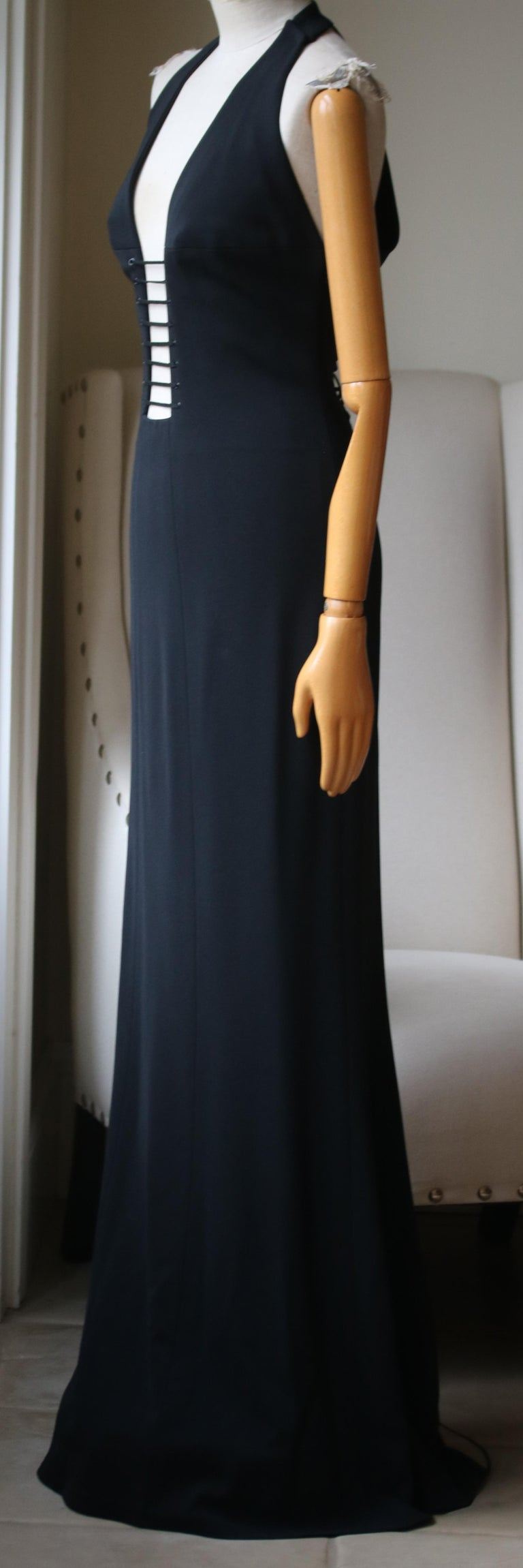 Azzedine Alaïa Haute Couture 2003 gown with lace up detail down the back. Deep v neck with cutout detail. Satin panels on the back. Size label has been cutout for comfort.   Size: FR 40 (UK 12, US 8, IT 44)  Dimensions: Approx.  Bust - 83.8 cm / 33