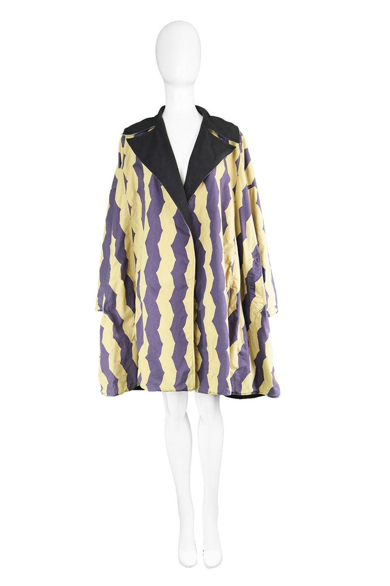 A rare and dramatic vintage women's jacket from the 90s by iconic fashion designer, Azzedine Alaia for his spring 1990 collection. Made in Italy, one one side is a textured black cotton with a subtle diamond pattern woven throughout and on the other