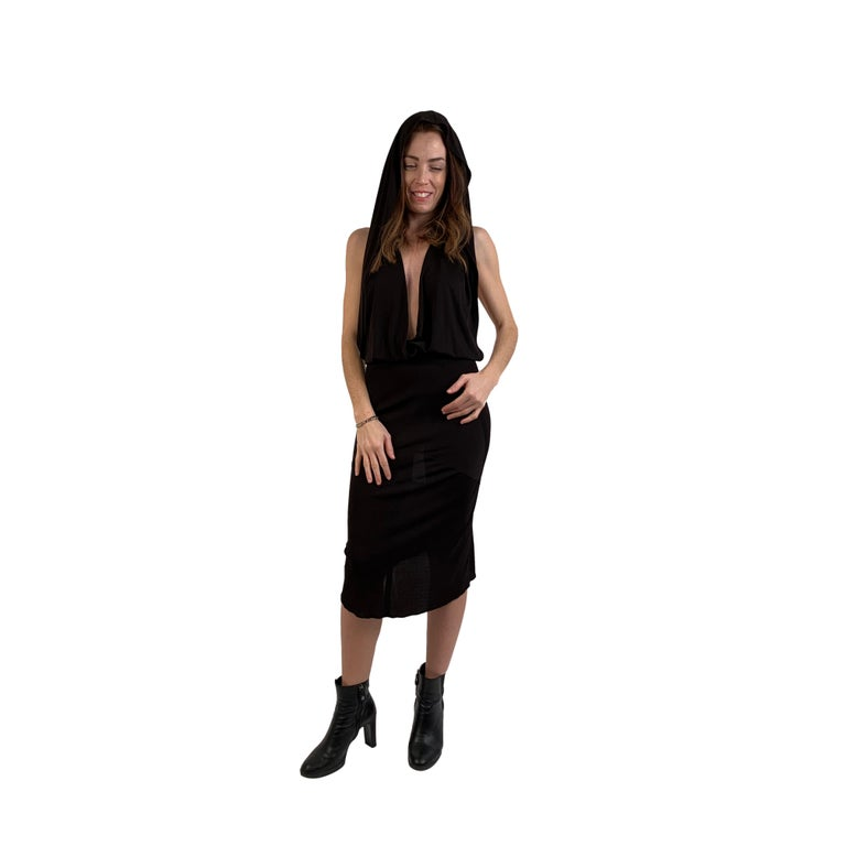 Description Vintage 1980's Azzedine Alaia hooded backless dress. Rare and iconic. Deep plunge neckline flows over the shoulders cascading into a beautiful and unexpected hood. If you choose to use the hood the dress becomes backless. Can be worn in