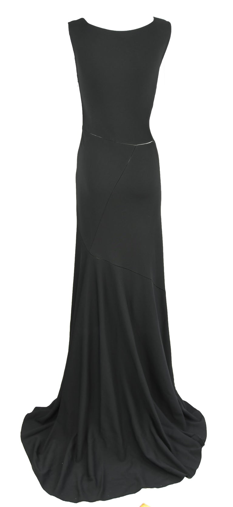 Original Azzedine Alaia jet black sleeveless gown, featuring a square neckline and train. Classic, gorgeous and elegant.  Composition is Viscose and Polyester. Marked Size Tag - Medium.