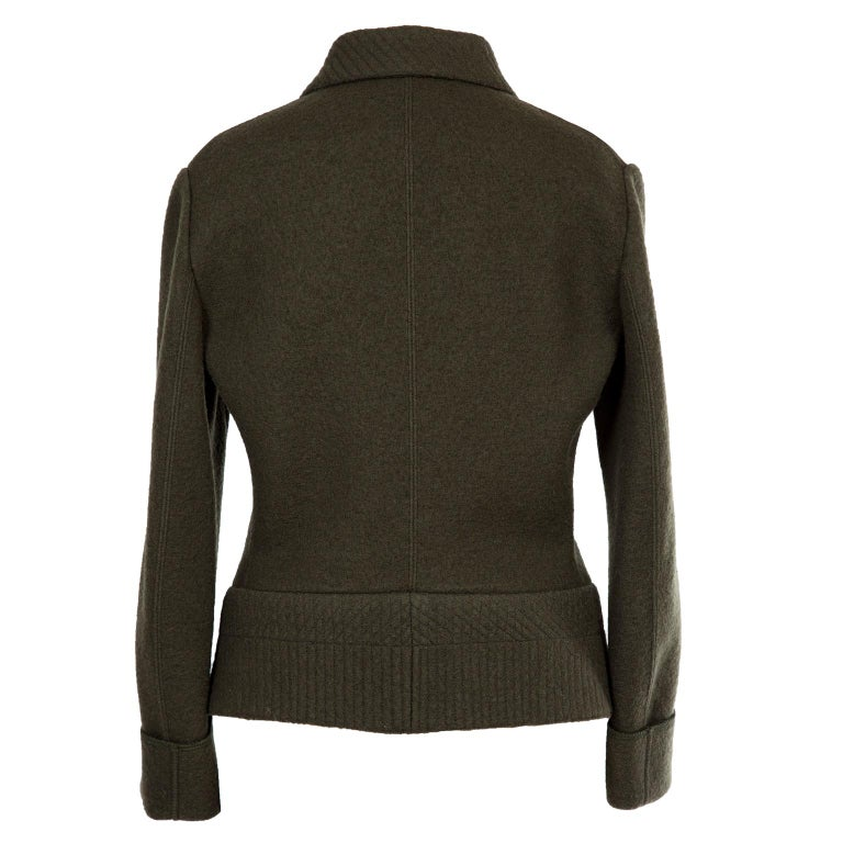 Azzedine Alaia deep khaki wool curved Jacket from 1980's. With folded cuffs, center front with hidden hook closures, boxy yet iconic Alaia silhouette with stitch details on collar and double faced waist. Very beautifully constructed.  Original
